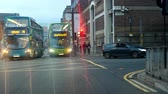 northwest : Liverpool, ENGLAND, UNITED KINGDOM - NOVEMBER, 2018: Car drivers point of view, POV. City buses turning from Whitechapel to Crosshall Street in the evening