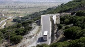 planalto : High angle view of bus and cars driving uphill road in Crete island of Greece, Lasithi Plateau in the background