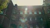плющ : Horizontal Panorama of Historic Building of Museum from Red Brick with Ivy and Sun Flare in Wroclaw, Poland