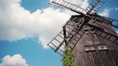 europe holland : Horisontal Panorama of a Traditional Antique Wooden Windmill with Blue Sky and Clouds in Summer