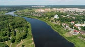 ortodoxo : Belarus, Polotsk Aerial Cityscape: Dvina River with Car Bridge and East Slavic Landmark - Cathedral of Saint Sophia on Sunny Summer Day. 4K Drone Panning Shot