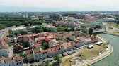 capitais : Aerial View of Minsk City Center (Capital of Belarus) - Upper Town, Trinity suburb on Svisloch River at Beautiful Summer Sunset during II European Games. Drone Zoom Shot Stock Footage