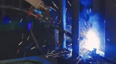 Automation mechanical procedure. Factory welding. Industrial Robot arm. Close-up Stock Footage