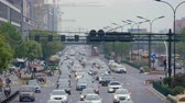 YIWU, CHINA - MAY 2018: Expressway in the metropolis centre, urban scene traffic jam in highway. Crowd road with cars, buses and motorcycles. Commercial industrial overpopulation concept, summer time