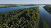 esplêndido : Gorgeous bird`s eye view of the Dnipro river with its two wide inflows, wild river banks, rows of trees, bushes, lawns, wetland, and lakes on a sunny day in summer. The skyscape is blue and nice.
