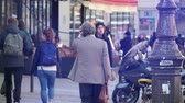 vitrin : Paris, France - November 6, 2017:An exciting view of tourists walking along a beautiful street in Paris in autumn in slo-mo. They look at shopcases in autumn.