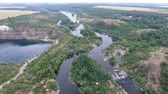 esplêndido : An impressive bird`s eye view of the curvy Dnipro river with inflows, islets, high trees, small cottages, cane and reed on a sunny day Stock Footage