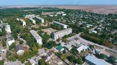 multistory : Splendid bird`s eye shot of Askania-Nova village, the center of Taurida steppe bio-reserve with various facilities, streets, and gardens in summer
