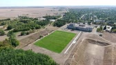 steppe : Exciting bird`s eye view of a big green football field with mowed grass and large hole areas in Askania-Nova on a sunny day in summer