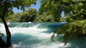 manavgat : Manavgat waterfall in Turkey. Trees with green leaves in front of the waterfall.