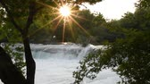 manavgat : Manavgat waterfall in Antalya - Turkey. Trees with green leaves in front of the waterfall and sunset. Stock Footage