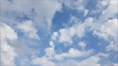 White clouds move across the clear blue sky. Cloudy blue sky background.