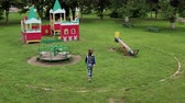 Funny cute girl is playing on schoolyard.