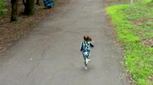 Nice little girl running to her mother.