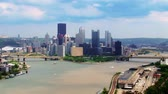 híd : A time lapse shot of the Pittsburgh skyline.  The corporate logos on the buildings have been digitally removed for general use.