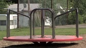 deserted : An empty carousel spins in a playground. Stock Footage