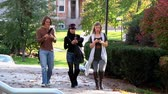 mobile phone : Students texting while walking on campus.