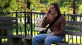 telemóvel : A student talks on his cellular phone on campus.