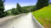 handheld : Riding an alpine slide.  Rider perspective. Stock Footage