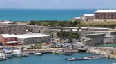 meşgul : Tourists visit the shops and attractions at Kings Wharf on the island of Bermuda. Stok Video