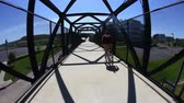 pontes : A man rides his bike while standing on a Pittsburgh bike trail. Stock Footage