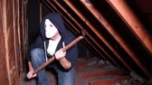 stolarz : A crazy masked killer is trapped in an attic crawlspace.