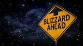 cuidado : A blizzard warning sign.