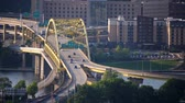 pittsburgh : Traffic passes over the Fort Duquesne Bridge over the Allegheny River in downtown Pittsburgh, PA.