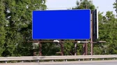 beira da estrada : Cars pass a blank billboard.Luma matte included for placement of your own content.