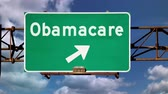 alerta : An Obamacare concept road sign.