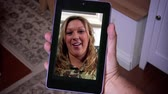 woman : A woman videochats on a tablet PC.  In 4K UltraHD.