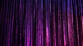 fechado :  A colorful curtain on a stage.