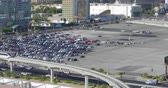 astarlı :  A time lapse view of a Las Vegas parking lot filling up with cars before a convention.