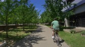 astarlı : A man rides a bike trail in Pittsburgh, PA.