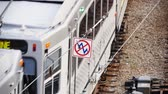 alerta :  A high voltage warning sign above a moving subway train.