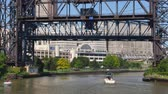 faaliyetler :  A draw bridge closes after a tour boat passes on the Cuyahoga River in Cleveland, Ohio.