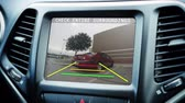 cuidado :  A cars backup camera in action.  Fictional screen content. Vídeos