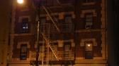 evler : A typical New York City apartment building establishing shot in the night.