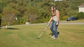 olhar : 6419 A teenager uses a metal detector. Stock Footage