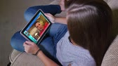 6432 A teenager video chats on her tablet PC.