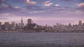 purple : The San Francisco skyline at sunset as seen from a boat on San Francisco Bay.