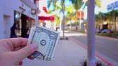 wealthy : Walking with money on Rodeo Drive. Stock Footage