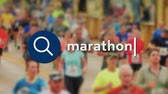 runners : Searching the Internet for marathon information. Background video is from the Pittsburgh Marathon. Stock Footage