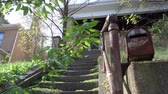 zdjęcia seryjne : A daytime establishing low angle shot of an old, abandoned home. Wideo