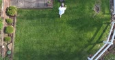 harcos : An aerial view of a man mowing the lawn.