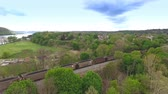beaver : An aerial establishing shot of a coal train cutting through the hillsides of Western Pennsylvania. Stock Footage
