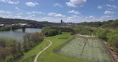 distante : A high angle aerial rising view of the Pittsburgh skyline as seen from Washingtons Landing. Stock Footage
