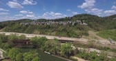 distante : A high angle aerial view of Millvale and Route 28. Stock Footage