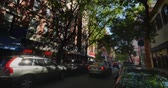 big apple : An establishing shot of apartment buildings above bars, restaurants and storefronts in Manhattan. Stock Footage
