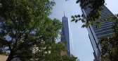 yukarıya bakıyor : NEW YORK - Circa July, 2016 - Looking up at the Freedom Tower as seen from the Hudson River Greenway Bike Trail. Stok Video
